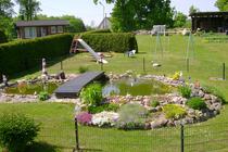 Ferienwohnung Hohensee Krumminer Wiek Garten Teich Spielplatz