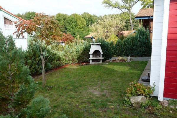 Ferienhaus Zislow Plauer See Garten Kamingrill