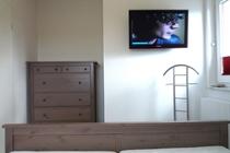 Ferienhaus Fleesensee Untergöhren Schlafzimmer unten TV