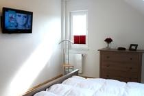 Ferienhaus Fleesensee Untergöhren Schlafzimmer oben TV