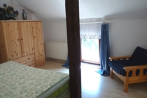 Mecklenburger Seenplatte Ferienhaus am See Schlafzimmer Sessel