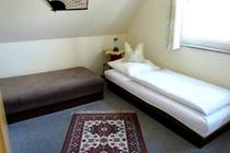 Ferienhaus Dabel Holzendorfer See fünftes Schlafzimmer DG Einzelbetten