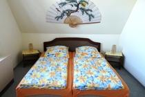 Ferienhaus Dabel Holzendorfer See fünftes Schlafzimmer OG Doppelbett